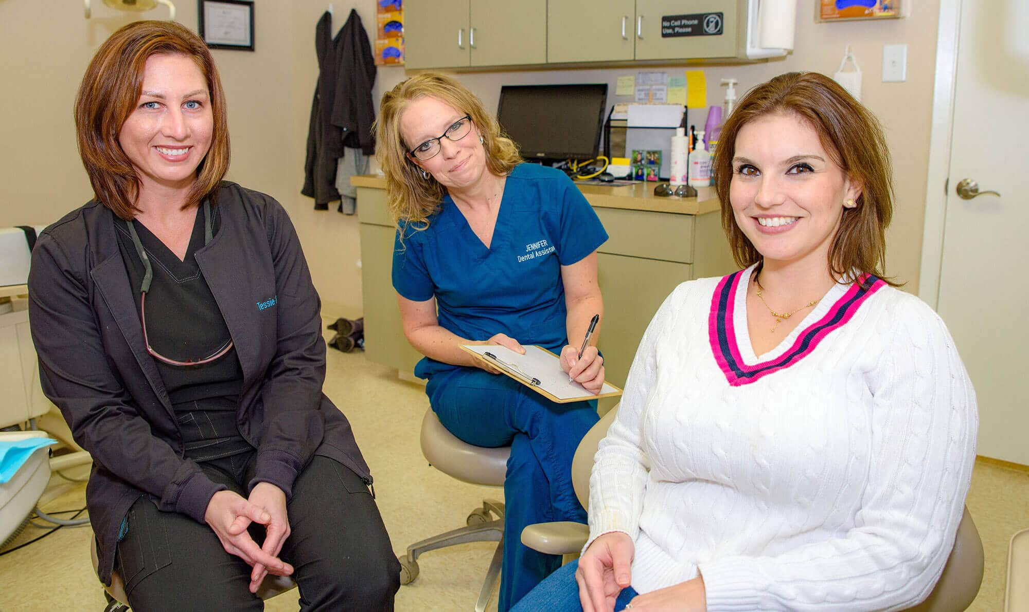 Tessie - Dental Hygienist & Jennifer – Dental Assistant With a patient after treatment